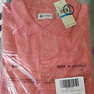 Nice coral colored polo shirt by Haggar. NWT